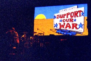 "Comcast billboard with ""Support Our War"" from the 2004 Greendale tour."
